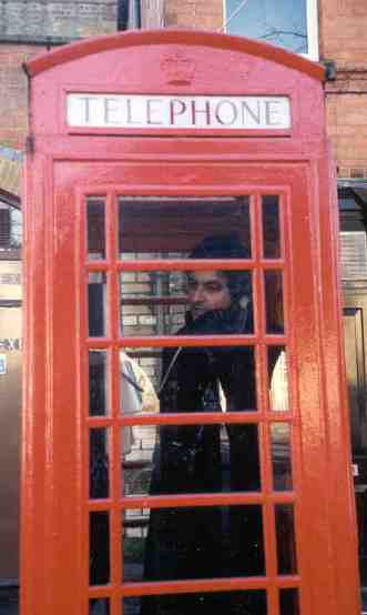 [Photo of MadAlfred in London phone booth 11/2000]